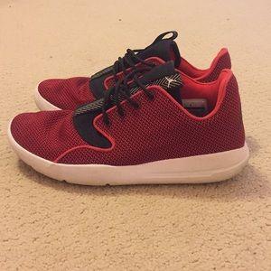 Black and red Jordan tennis shoes